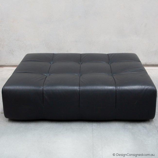 black leather tufty time ottoman