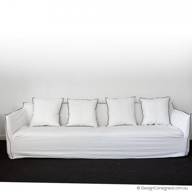 white linen slip cover sofa