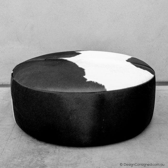 round cowhide designer ottoman